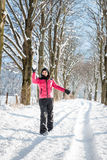 Young woman throwing a snowball. In the winter Stock Image