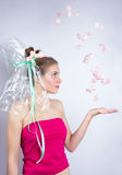 Young woman throws a candy, marshmallow, makeup style beauty fan Stock Images