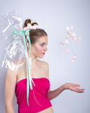 Young woman throws a candy, marshmallow Stock Image
