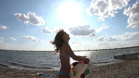 The girl throws her hat up in the air. A young woman throws her hat to the sky Slow motion video stock video