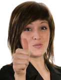 Young woman with thumb up. Portrait of attractive young woman with thumb up, isolated on white background Stock Photography