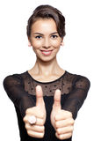 Young woman with thumb up Stock Images