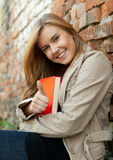 Young woman with thumb up, outdoors Stock Image