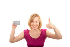 Young woman  thumb up and presenting credit card Royalty Free Stock Images