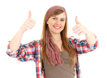 Young woman with thumbs up. White background Royalty Free Stock Photos