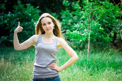 Young woman thumbs up Royalty Free Stock Photos