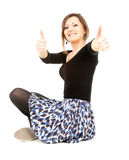 Young woman with thumbs up, full length. Successful elegant young woman with thumbs up, full length, white background Stock Photography