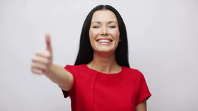 Young woman with thumbs up stock video