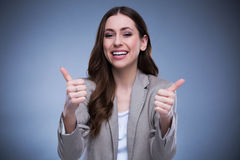 Young woman with thumbs up Royalty Free Stock Photography