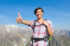 Young Woman with Thumbs Up at Top of Mountain Stock Images