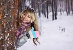Young woman thumbs-up in winter forest Stock Photos