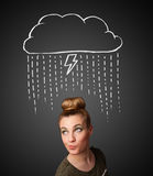 Young woman with thundercloud above her head Stock Image