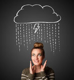 Young woman with thundercloud above her head Royalty Free Stock Photos