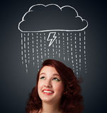 Young woman with thundercloud above her head Stock Photography