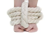 Young woman with tied up hands Royalty Free Stock Images