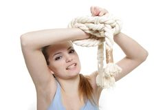 Young woman with tied up hands Royalty Free Stock Photography