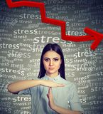 Young woman with time out hand gesture requesting to decrease stress level. Woman with time out hand gesture requesting to decrease stress level royalty free stock photo