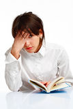Young woman tired of reading a book. Young woman with blue eyes reading a book,tired and giving up, on white background stock photo