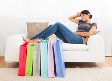 Young Woman Tired Of Shopping Royalty Free Stock Photography