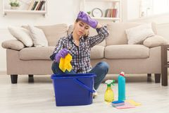 Young woman tired of spring cleaning house stock photo