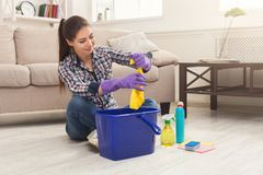 Young woman tired of spring cleaning house stock image