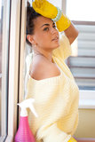 Spring Clean out. Young woman tired of washing windows in the flat Stock Images