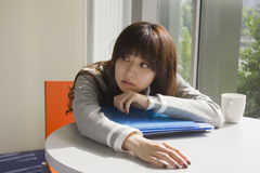 Young woman tired with work Stock Images