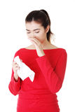 Young woman with tissue Royalty Free Stock Photos