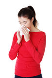 Young woman with tissue - sneezing Royalty Free Stock Images