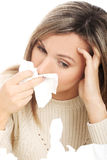 Young woman with tissues crying/ having runny nose. Royalty Free Stock Image