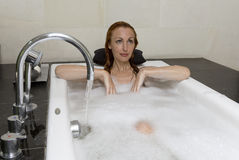 The young woman to Spa procedures Stock Photography