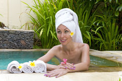The young woman to Spa procedures in poo Royalty Free Stock Photography