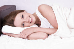 Young woman to stay in bed. Beautiful young woman to stay in bed Stock Photography