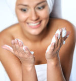 Young woman about to wash her face Royalty Free Stock Photo