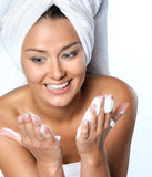 Young woman about to wash her face Stock Image