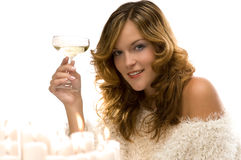 Young woman toasting with champagne. Isolated on white background Stock Images
