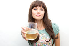 Young woman toasting with a glass Stock Photo