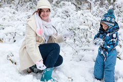 Young woman and toddler boy having on winter day Stock Image