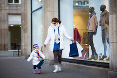 Young woman and toddler daughter enjoying shopping Royalty Free Stock Images
