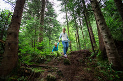 Young woman and toddler son walking down a path Royalty Free Stock Images