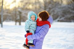Young woman with toddler at the winter Royalty Free Stock Image