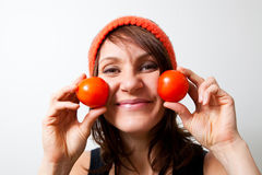 Young woman with tomato cheeks Royalty Free Stock Photography