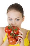 Young woman with tomato. Stock Photo