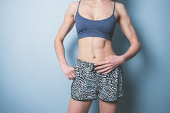 Young woman with toned abs in sports clothing Stock Photography