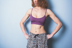 Young woman with toned abs in sports clothing Royalty Free Stock Photo