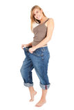 Young woman in too great trousers Royalty Free Stock Image