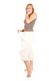 Young woman in too great trousers Royalty Free Stock Images