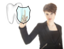 Young woman with tooth shield symbol isolated Stock Image