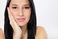 Young woman with toothache Stock Images