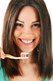 Young woman with toothbrush cleaning her teeth Royalty Free Stock Photography